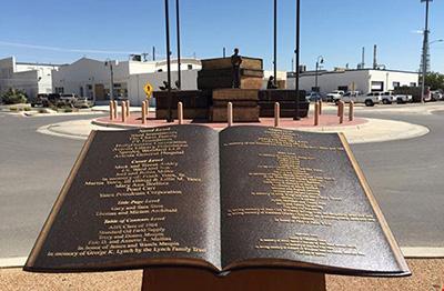 Cast bronze book plaque